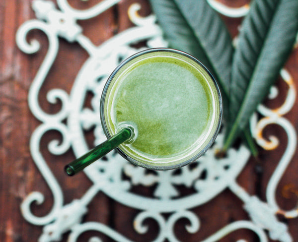 Glass Drinking Straw in Green Juice