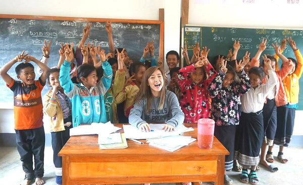 Lindy Tsang aka Bubzbeauty at a school in Laos she helped build through her Pencils of Promise campaign.
