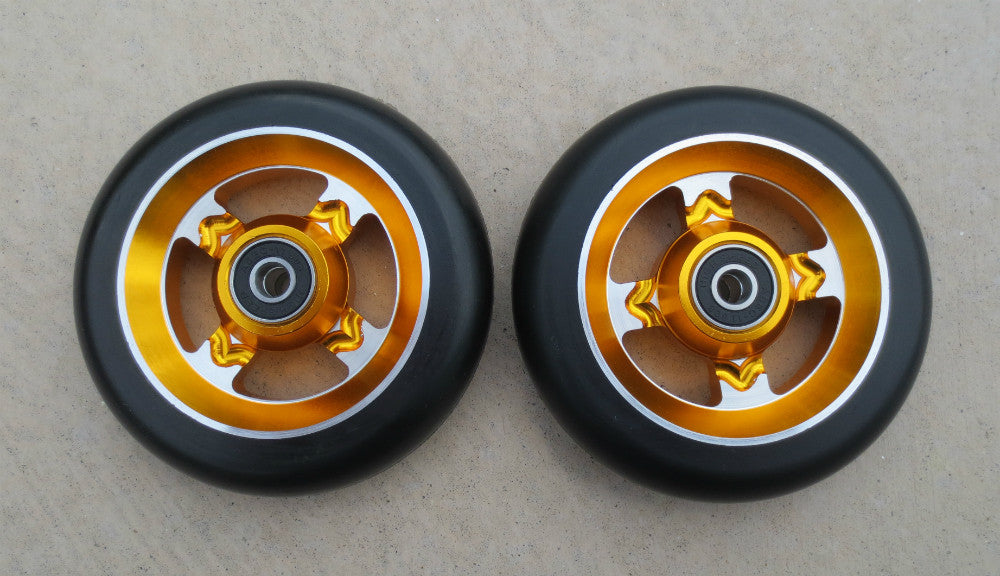 110mm Black on Gold 4 Spoke Metal Core Scooter Wheels