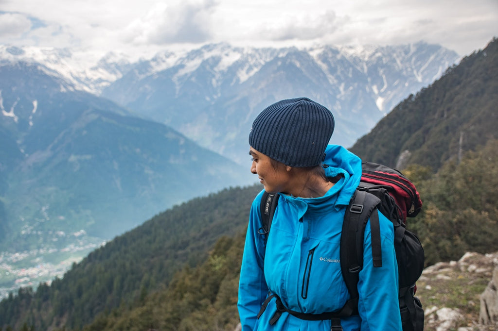 Woman hiking in blue jacket