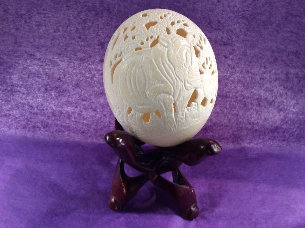 Carved Ostrich Egg and three legged adjustable Stand