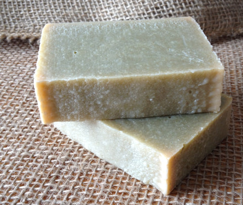 What causes my handmade cold process soap to be sticky with sand like grains?
