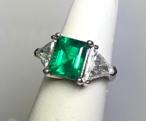 A Fantastic Emerald and Diamond Platinum Ring