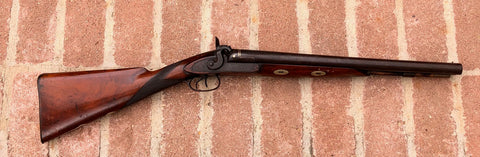 An Antique English Double Barrel Percussion Coach Shot Gun by MORTIMER