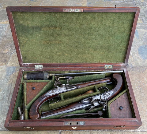 A Wonderful and Very Rare Cased Pair of English Silver Mounted Flintlock Dueling Pistols by TWIGG, LONDON