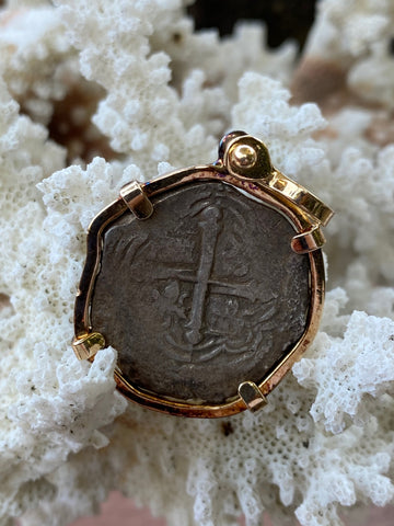 An Antique Spanish New World Shipwreck Recovered Silver 2 Reales Cob Coin set in a 14K Gold Bezel