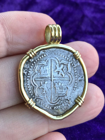 A Fantastic Potosi 2 Reales COB set in an 18k. Gold Bezel,