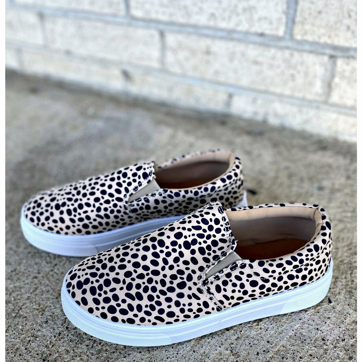 dalmation leopard slip on sneakers