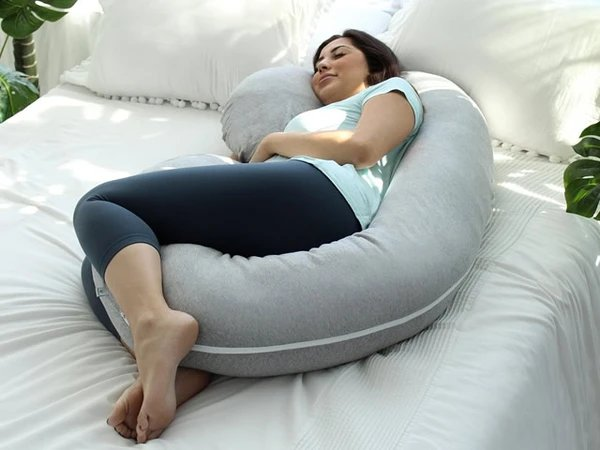 3. pregnant mum-to-be lying on a super comfy C shape pillow