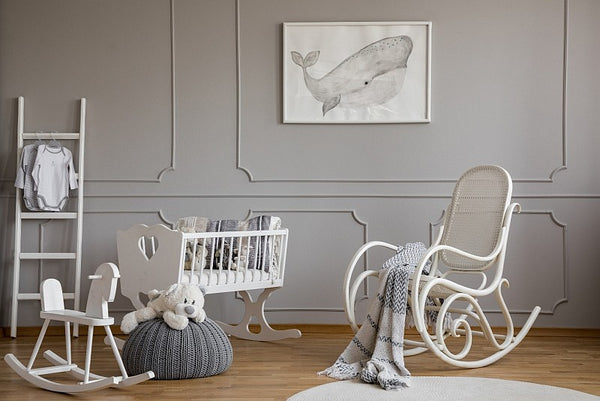 Nursery bedroom with white cot and rocking chair