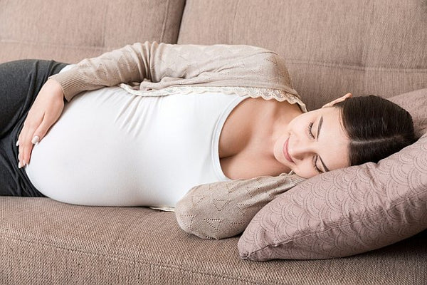 5. sleeping pregnant woman on a couch