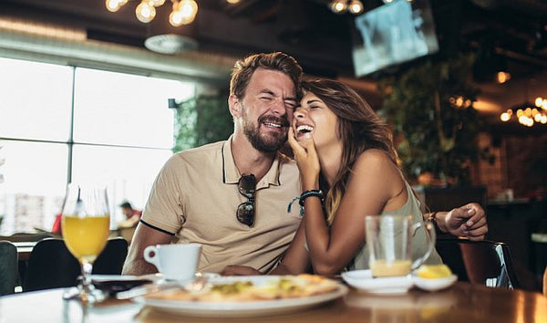 Couple laughing over diner