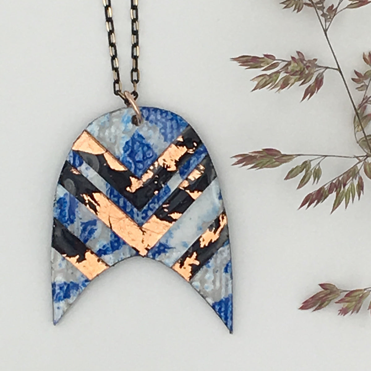 Bly batik textile necklace in cobalt with rose-gold/black chevrons