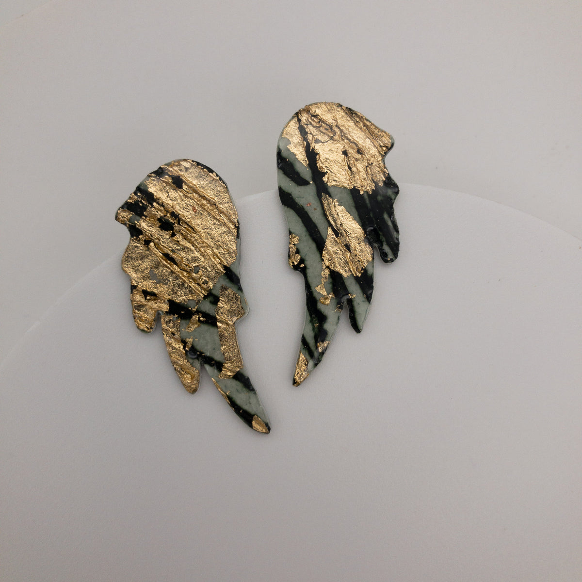 Wings of Desire sgraffito earrings in gold/forest green