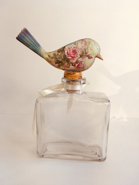 Bottle with bird topper