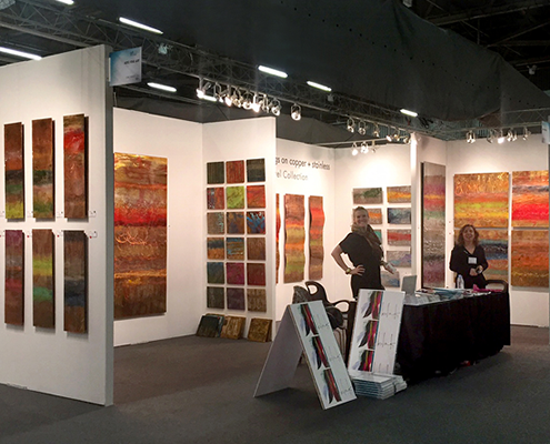 Art Design Consultants and BLINK booth featuring Ken Rausch copperworks Jewel Collection at ArtExpo New York