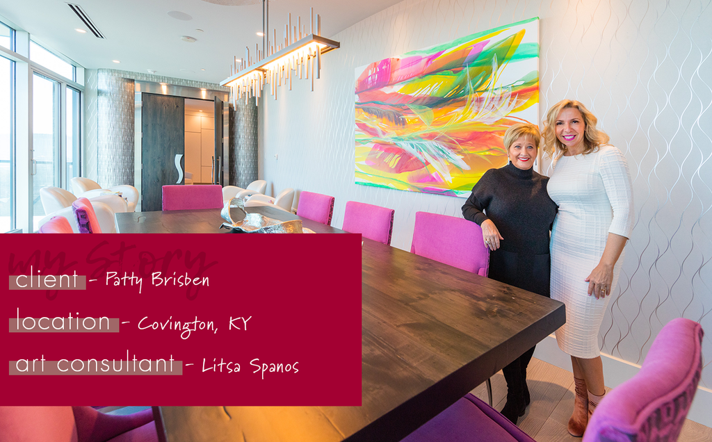 residential art consulting project for a high-end condo. Litsa Spanos and Patty Brisben stand in Patty's newly renovated dining room with a stunning piece of art.