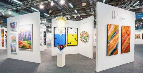 image of blink art's booth at artexpo new york 2016 where they help artists sell their work.