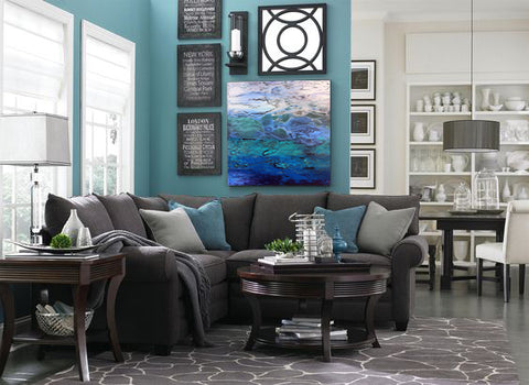Living room with gray and teal. Artwork by Alicia Dunn