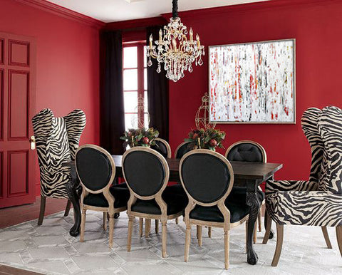 Red dining room with artwork by Clara Berta