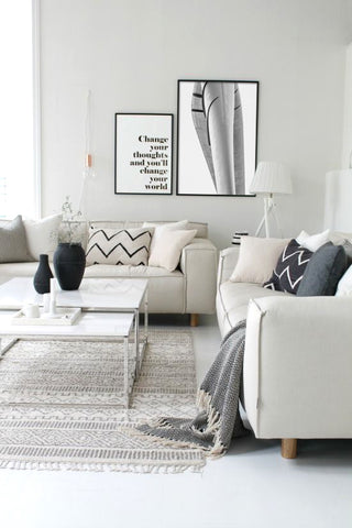 Black and white living room decor. Artwork by Dave Romero