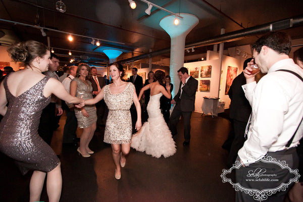 Whitney and Mike dance floor | Weddings and Events at Art Design Consultants Gallery