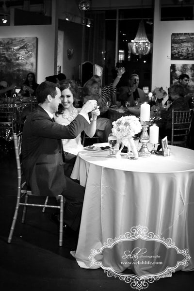 Whitney and Mike toast | Weddings and Events at Art Design Consultants Gallery