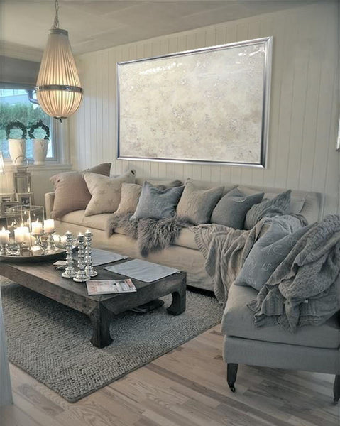 White and gray living roomw ith art by Jeannine Dostal I Art Design Consultants