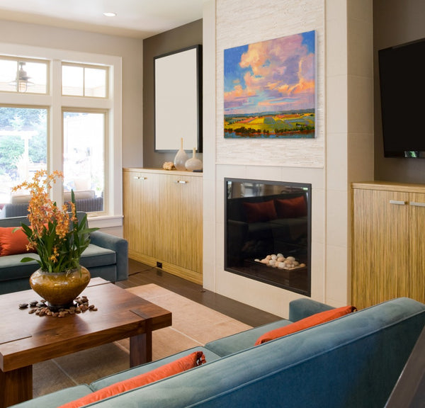 Orange and blue livng room with landscape painting by Lynn Dunbar | Art Design Consultants