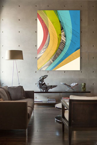 Industrial living room with colorful artwork. Art by Dave Romero: Vortex