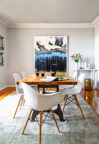 Modern dining room design style with artwork by Evan Hildebrant