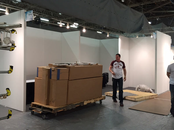 Art Design Consultants booth installation at ArtExpo New York