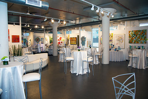 Special event with dressed tables at the Art Design Consultants (ADC) art gallery