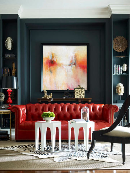 Autumn inspiration living room decor with red couch. Artwork by Karen Hale_Blink Art Resource