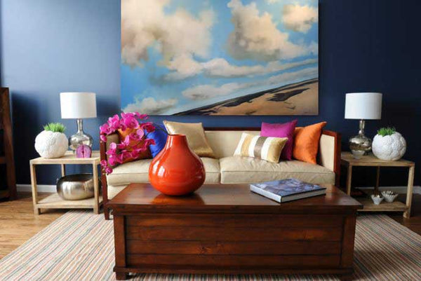Living room interior with cloudy blue sky painting by Ken Wells | Art Design Consultants