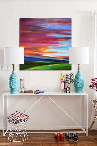 Sidetable in hall with vibrant sunset painting by Mary Johnston | Art Design Consultants