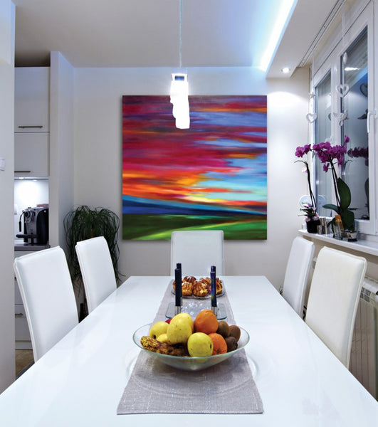 Modern dining room with bold, colorful sunset painting by Mary Johnston | Art Design Consultants