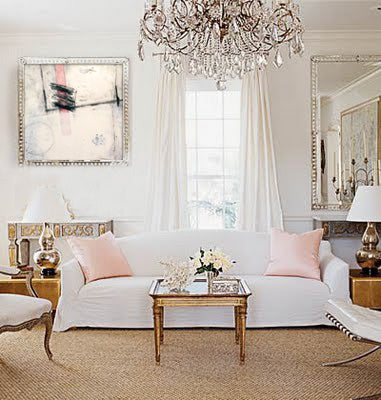 White and pink delicateliving room style with chandelier and mixed media artwork by Tom Owen | Art Design Consultants