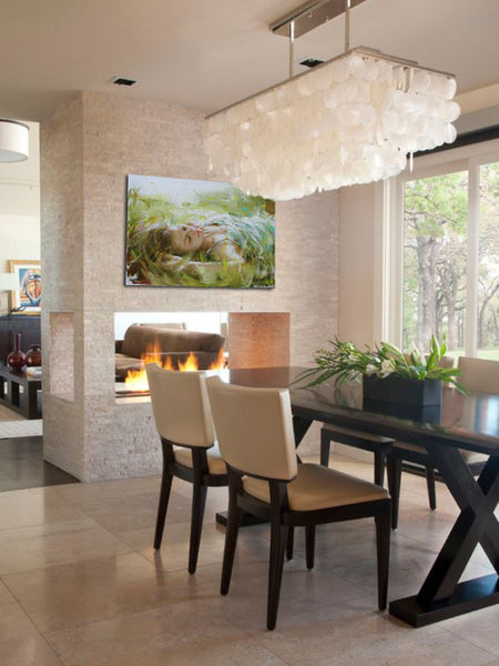Dining room with fireplace and artwork by Vittorio Dangelico | Art Design Consultants