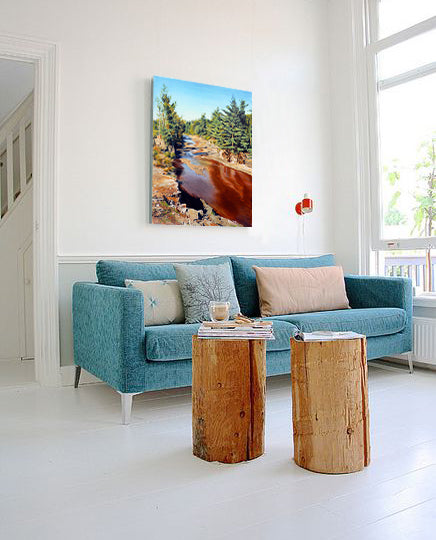 Living room design with natural wood footstools and landscape painting by Jim 'Dauber' Farr | Art Design Consultants