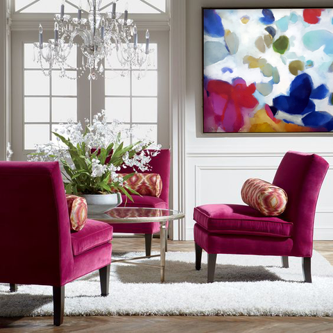 Seating area featuring fuschia and pink with floral painting. Artwork by Jamie van Landuyt