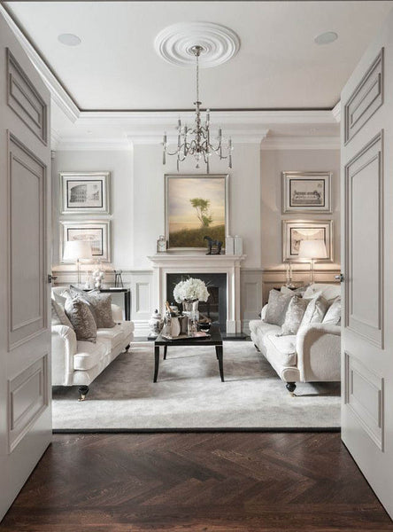 White formal living room with landscape painting focal point by Josie Gearhart | Art Design Consultants