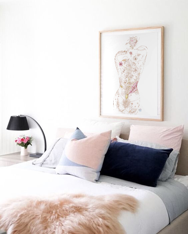 Pastel bedroom with pink and navy. Artwork by Karen Robey