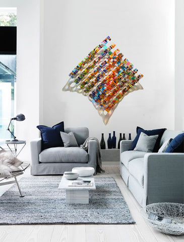 Gray and blue living room with dimensional glass woven sculpture by Renato Foti
