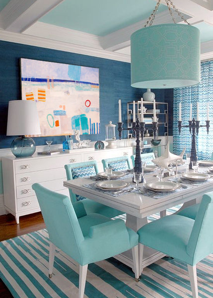 Blue dining room with art by Tom Owen I Art Design Consultants