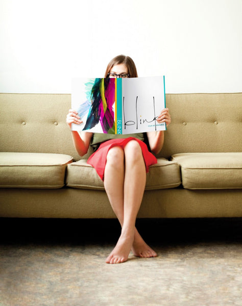 Woman on couch reading Blink Art Resource