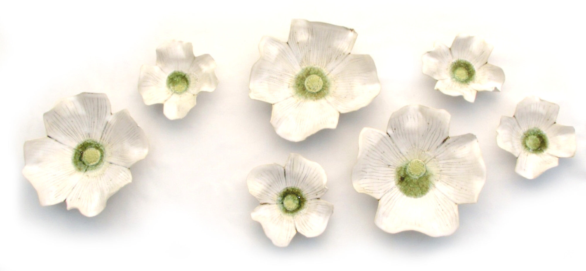 Dogwood Blossoms / 60 x 24 x 4 / porcelain ceramic wall sculptures