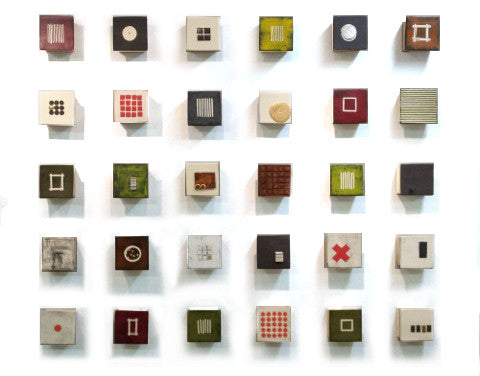 Wall of Squares / 55 x 45 x 2.5 / slab-built stoneware with additions of slips - underglaze - glaze - paint - cold wax and metal leaf