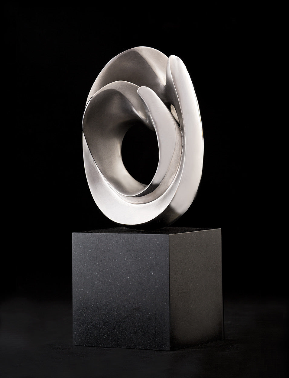 Wave Form II / 15 x 6 x 6 / stainless steel on granite base
