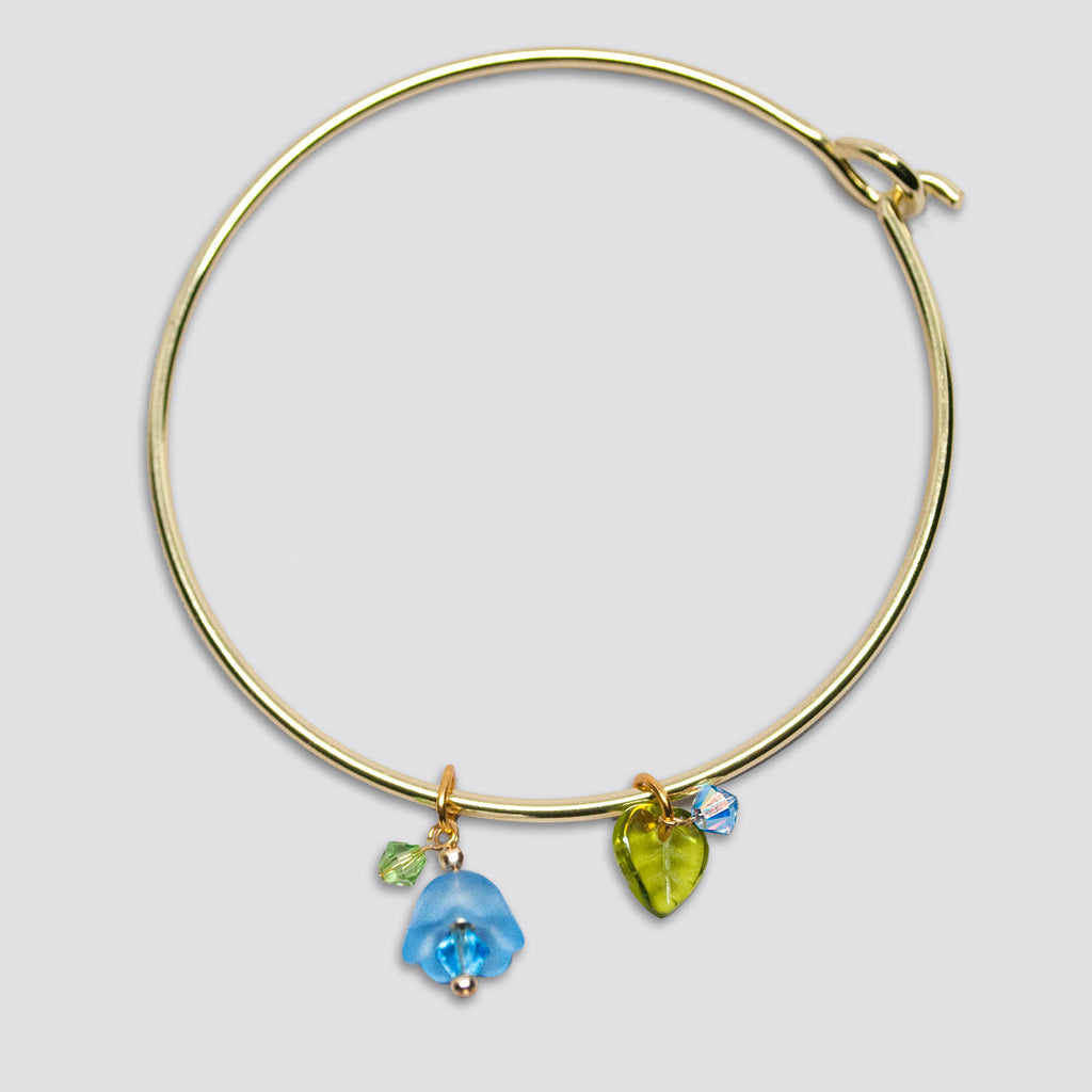 'Flower' (Blue) gold-tone bangle bracelet with Swarovski crystals